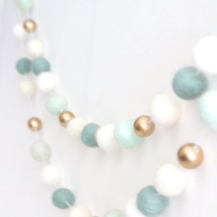 https://www.etsy.com/listing/261751894/mint-and-gold-felt-ball-garland-mint?ref=hp_rv